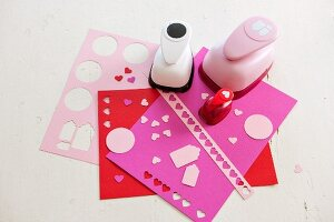 Pattern punches on sheets of craft paper with punched holes