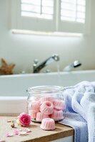 Hand-made bath bombs shaped like miniature Bundt cakes in mason jar