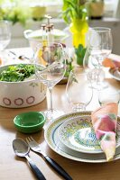 Table set with colourful summery crockery