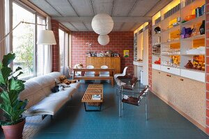 Living room with brick walls in industrial loft apartment
