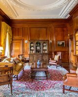 Grand interior with panelled walls and stucco ceiling