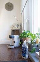 Hand-made concrete clock in kitchen