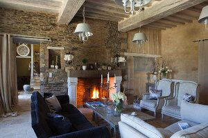 Open fire in comfortable interior of rustic country house