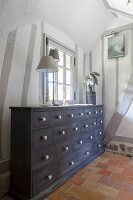 Chest of drawers in farmhouse with half-timbered interior walls