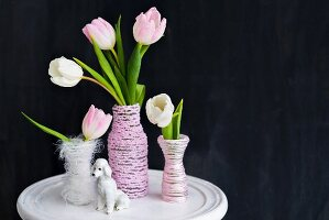 Tulips in vases covered in cord and poodle ornament
