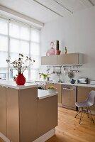 Open-plan kitchen with beige cabinets