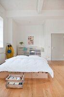 Minimalist bedroom in urban loft apartment