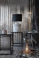 Various table lamps on side tables in grey interior