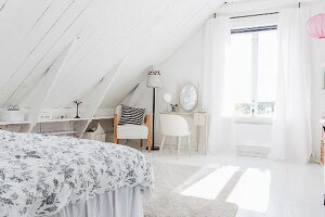 White wood-clad sloping ceiling, shelves fitted in knee wall, dressing table and rug in bright attic room