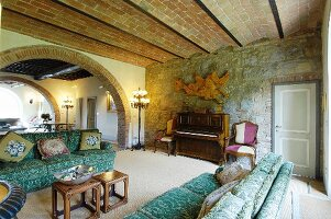 Stone wall and arches in Mediterranean living room