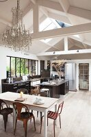 Kitchen and dining table below exposed roof structure