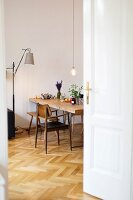 Vintage chair on herringbone parquet floor in dining room