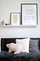 Framed prints on narrow shelf above sofa
