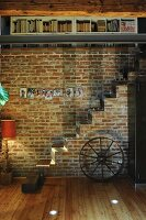 Family photos above modern metal staircase mounted on brick wall
