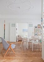 Double doors and stucco ceiling in period apartment