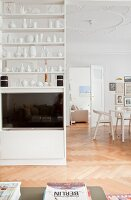 Collection of vases on partition shelving in open-plan interior