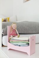 Crocheted princess dolly in pink dolls' bed