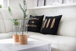 Glass vases and cushions decorated with cork sheets