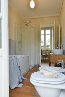 White bathroom suite in renovated country house