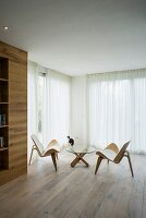Designer furniture and oak floor in minimalist interior