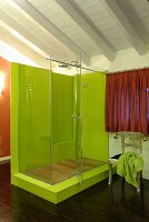 Lime-green shower on platform in modern bathroom