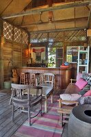 Bar in wood and bamboo cabin with lounge furniture, Langkawi, Malaysia