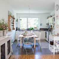 Simple dining set in front of window in rustic kitchen-dining room