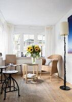 Vase of sunflowers in living room with lattice windows