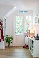 Cheerful foyer with lattice window in door and table lamps