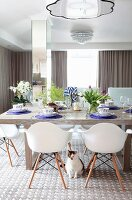 Spring dining table arrangement and plastic shell chairs in dining room