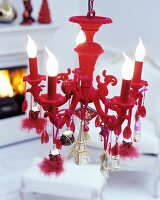 Red chandelier decorated with pendants of various types