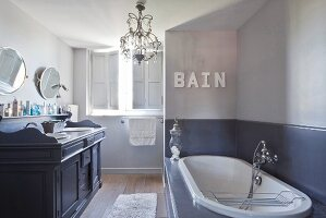 Vintage-style washstand in elegant bathroom in shades of grey