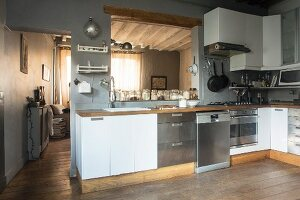 Rustic kitchen with serving hatch
