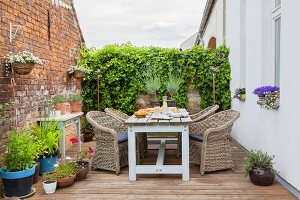 Rustic seating area on terrace with brick wall