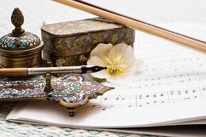 Vintage, artisanal writing utensils, sheet music and hellebore flower