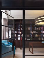 Elegant traditional library with turquoise reading chairs