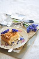 Crumb cake decorated with grape hyacinths