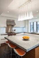 Large island counter and bar stools in modern kitchen