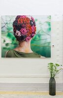 Photo of woman wearing colourful crocheted hat on wall