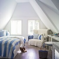 Attic bedroom in bed in blue and white