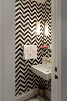Black and white zigzag wallpaper in small bathroom