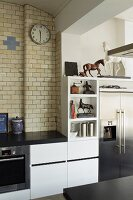 Glazed bricks above modern kitchen counter