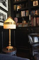 Antique table lamp in library