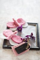 Hand-made gift tag and pink felt butterflies on black vintage picture frame