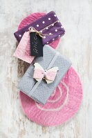 Wrapped gifts decorated with hand-made gift tags on felt mats