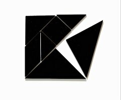 Tangram – Chinese game made from black geometric shapes