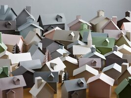 Collection of paper models of houses and pine trees