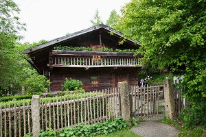 Rustic log cabin with paling fence