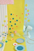 Wallpaper and gift wrap brightened up with colourful spots of paint