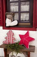 Hand-made, festive scatter cushions in the shapes of a tree, star and boot